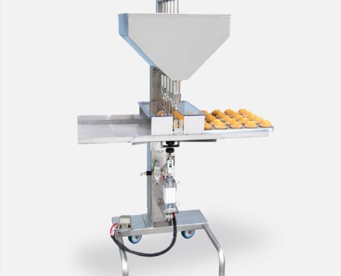 Inyectadora semiautomática para rellenos en pastelería.